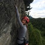 girl climbing smiling for camera